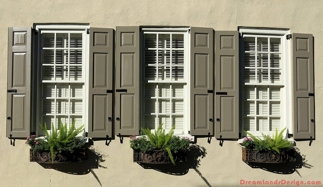 Shutters and window boxes in wrought iron holders