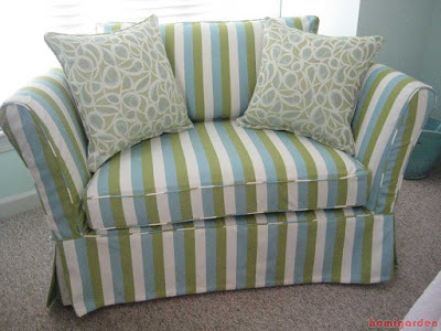 Small loveseat with custom striped slipcover